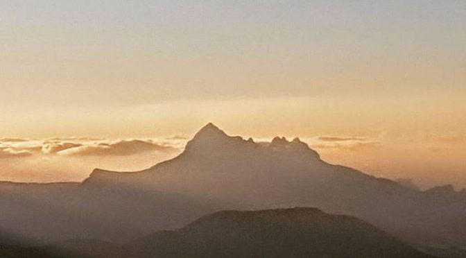 Sierra Bernia at sunrise from Confrides Castle. The rays of the new day light up…